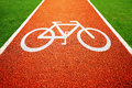 Bicycle lane mark white sign for track surrounded by grass in the park Royalty Free Stock Images