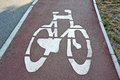 Bicycle lane road sign on gray asphalt Royalty Free Stock Photos