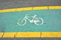 Bicycle lane sign on road Royalty Free Stock Photo