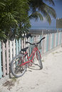 Bicycle leaned up against a colorful picket fence Royalty Free Stock Photo