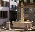 Bicycle leaning against water fountain in the old town of Zurich, Switzerland Royalty Free Stock Photo