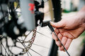 Bicycle mechanic hands adjusts disk brakes Royalty Free Stock Photo