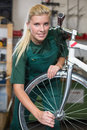 Bicycle mechanic repairing wheel on bike in a workshop tyre or Stock Images