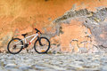 Bicycle near a stone wall