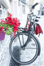 Bicycle with pannier bags red parked outside the front door of a house on a street in bruges belgium Royalty Free Stock Photography
