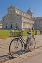 Bicycle parked in front of pisa cathedral with green field during summer time at piazza dei miracoli Royalty Free Stock Photography