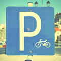 Bicycle parking lot sign close up retro style filtred image Stock Image