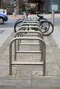 Bicycle parking spaces on a city street Royalty Free Stock Photography