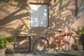 Bicycle parking under the shade beside the wall Royalty Free Stock Images
