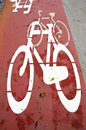 Bicycle path crosses carriageway road section. Stock Photo