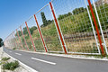 Bicycle path and fence Stock Photos