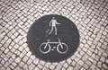 Bicycle and pedestrian lane road sign on the ground in lisbon portugal Royalty Free Stock Photos
