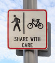 Bicycle and pedestrian lane road sign on pole post, bike cycling Royalty Free Stock Photo