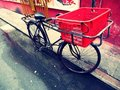 Bicycle with a red basket (Lomo feel) Royalty Free Stock Photos