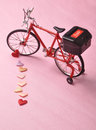 Bicycle red toy with hearts on textured background Stock Images