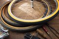 Bicycle repair. Repairing or changing a tire of an vintage bicycle. Royalty Free Stock Photo