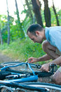 Bicycle repair in the woods Stock Photo