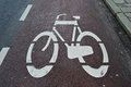Bicycle road pad sign image on a Stock Photo