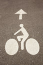 Bicycle road sign and arrow on the asphalt Royalty Free Stock Images