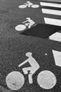Bicycle road sign painted asphalt Royalty Free Stock Images