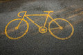 Bicycle road of sign yellow painted on the asphalt Stock Photography