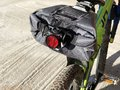 Bicycle`s headlight and bag close-up across neon bicycle. Sport. Transport. Equipment Royalty Free Stock Photo