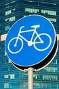 Bicycle sign on skycrappers background. Bycicle road Royalty Free Stock Photo