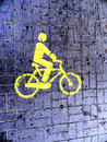 Bicycle sign yellow on the blue road Stock Images