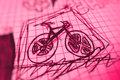 Bicycle sketch a of a on a checkered paper with pink colour Stock Photos