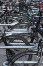 Bicycle stand bike parking rack with many bicycles Stock Image