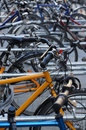 Bicycle stand bike parking rack with many bicycles Stock Photography