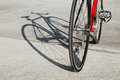 Bicycle standing in the parking lot and its shadow red single speed Stock Image
