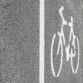 Bicycle symbol on the road asphalt Stock Image