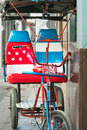 Bicycle taxi in Havana Cuba decorated with American flag Royalty Free Stock Photo