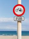Bicycle traffic is limited road sign bike on the beach and small waves lapping at the sandy beach Stock Photos