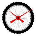 Bicycle wheel clock face a knobbly tyre on a with hands making a Royalty Free Stock Images