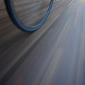 Bicycle wheel with motion blur in street Royalty Free Stock Photos