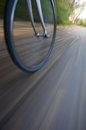 Bicycle wheel with motion blur in street Stock Photography