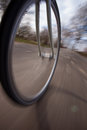 Bicycle wheel in motion on street Stock Photos