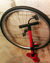 Bicycle wheel and pump Royalty Free Stock Photo