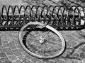 Bicycle wheel on a rack left from a stolen bike Royalty Free Stock Photo