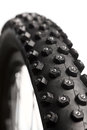 Bicycle wheel with winter tyre knobby mountain bike tire spikes close up Stock Photography