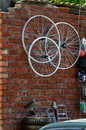 Bicycle wheels a wheel on a brick wall bazaar in astrakhan russia Stock Photos