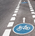 Bicycle zone mark of a crossing city life Stock Photos