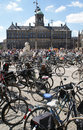Bicycles against Royal Palace Amsterdam Stock Photography