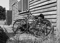 Bicycles against a wall old rusted leaning on wooden in black and white Royalty Free Stock Photography