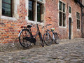 Bicycles in belgium old leaned against old houses leuven Stock Photos