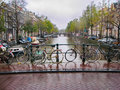 Bicycles and Bridge Over Canal in Amsterdam Royalty Free Stock Photo