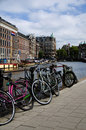 Bicycles on the canal amsterdam holland Royalty Free Stock Image