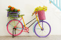 Bicycles colorful with bunches of flowers Stock Photos